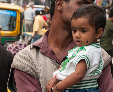 a man shops with his daughter on 8th cross, Sampige Rd, Bangalore.