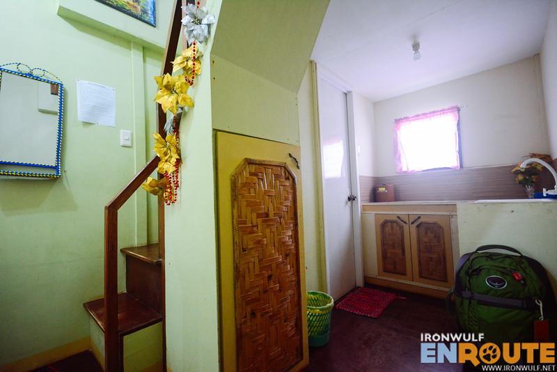 Stairs, kitchen, storage and bathroom