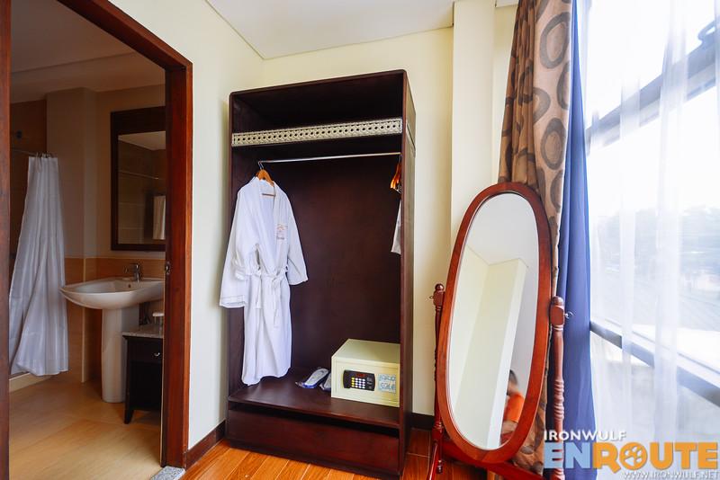 Clother hanger, safe, bath robe and the bathroom