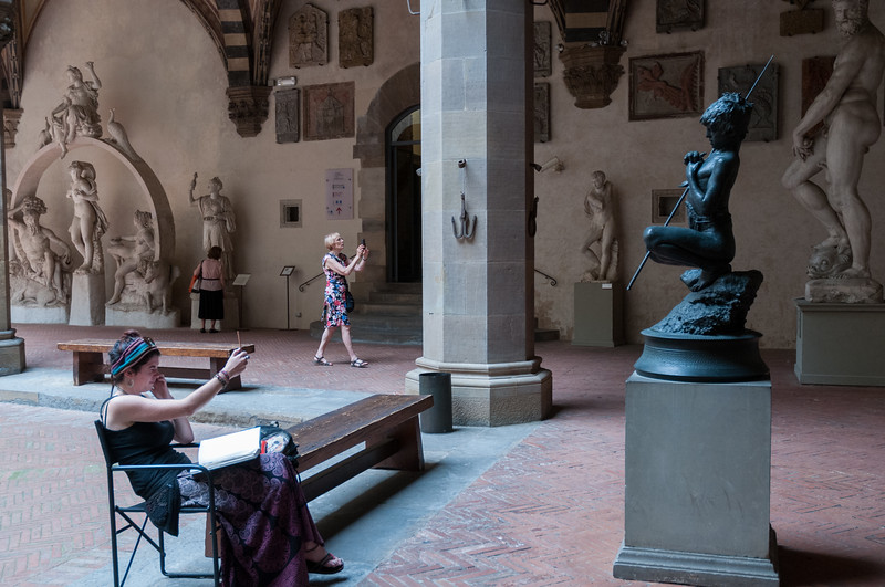 """An art student sketching """"Il Pescatorello (small fishboy)"""" at Bargello museum - Florence."""