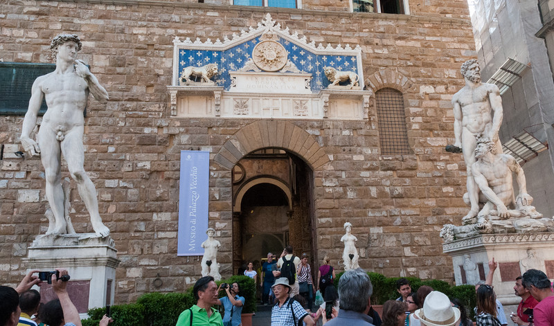 Entrance to Palazzo Vecchio, with replica of Michelangelo's David on the left - Florence.