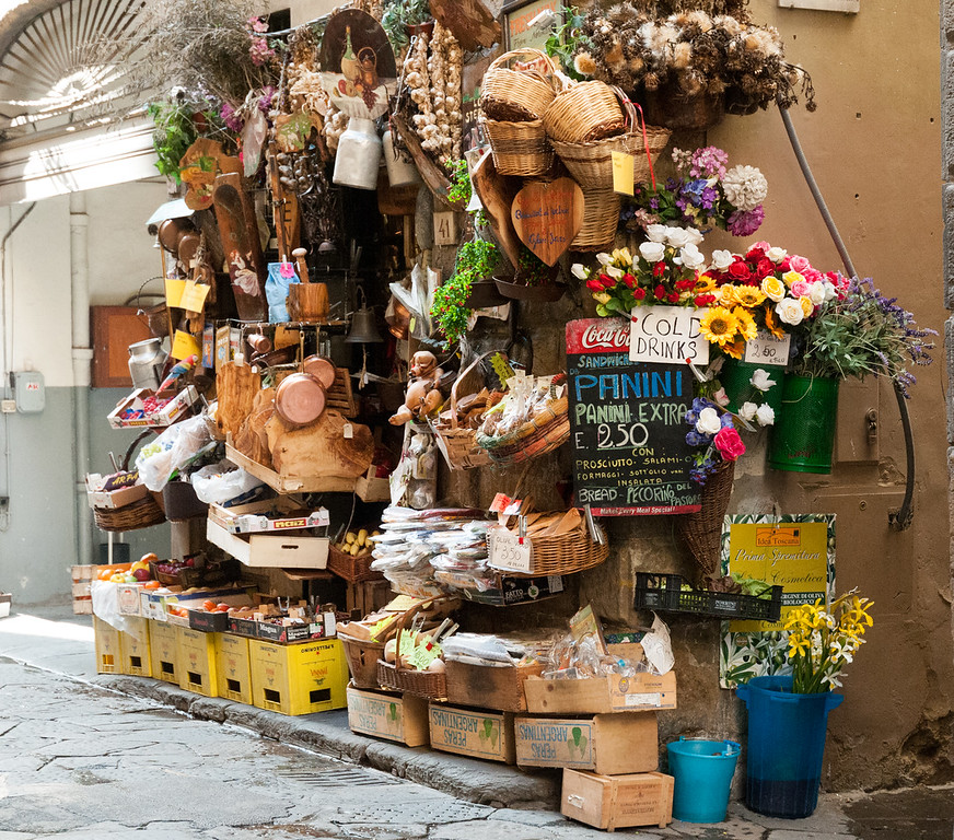 A flower vendor on a narrow lane in Florence.