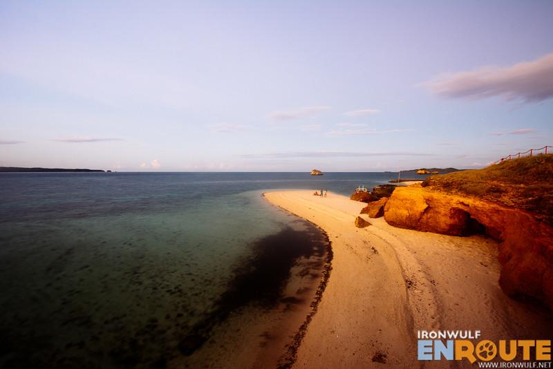 Warm morning glow on the islet white beach