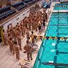 Midshipmen preparing for a 700 meter fitness swim in uniform