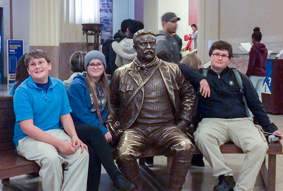 Sitting with Teddy Roosevelt, Museum of Natural History, New York City.