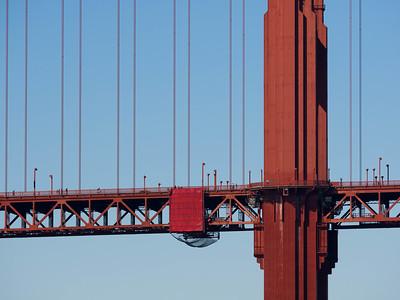 Pedestrians near the south tower of the Golden Gate Bridge