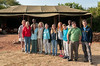 Safari group photo: Peggy, Amy, Erin, Doe, Pam, Mara, Isabel, Andy, John, David; with guides Robert and Freddy in back. At Serengeti East nyumba, Enashiva Reserve, last morning of the safari.