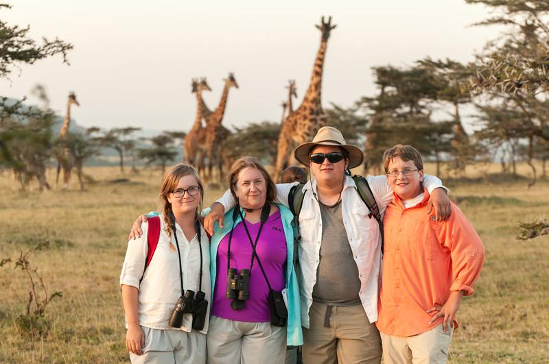 Family photo with giraffes at the Enashiva nyumba, our last camp near the Serengeti.