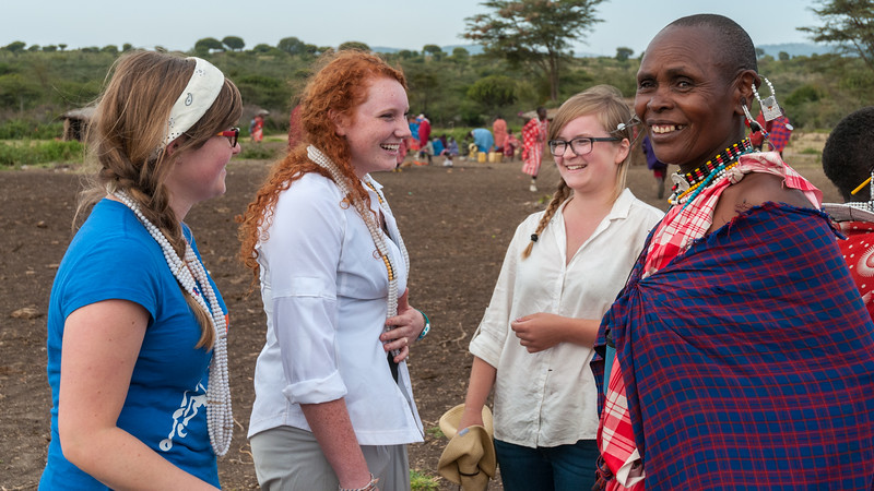 The girls learn to dance with the Maasai women at the Maasai boma.