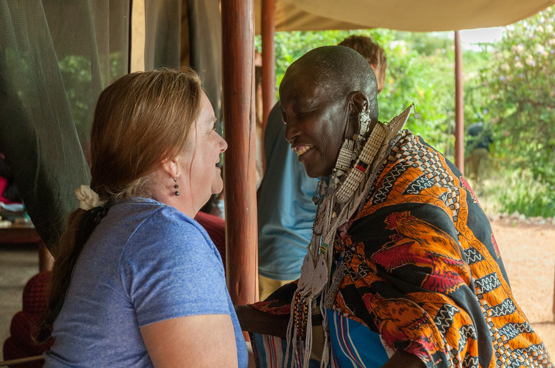 Pam greets the elder storyteller when she visits our camp to share stories.