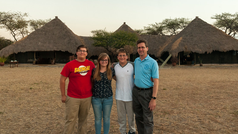 John, Mara, Andy, David pose for a Crossroads Academy picture at West-central Serengeti nyumba.