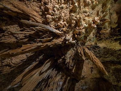 Looking up at stalactites