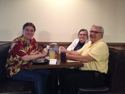 Mike and his parents at Round Table pizza. (where is the round table?)