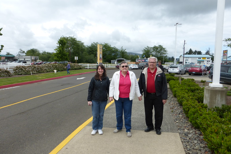 Diane with Mike's parents walking to the entrance of the factory.