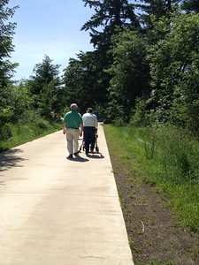 Mike's parents walking along the greenway.