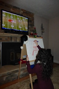 Ally drawing a Christmas message while we watch the Browns win! It's a Christmas miracle!