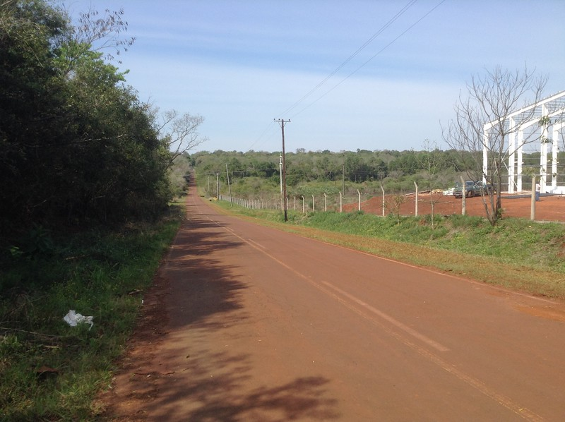 The start of the side-road towards the ruins of Santa Ana. Taken mainly to show the nature of the local landscape, which is low, with an even covering of small trees, and with intensely red soil.