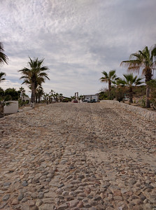 Cobbled road up to main entrance to dirt road toward Los Barilles