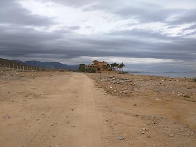 Road toward N from beach access. Last house