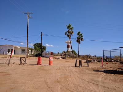 Approach to lighthouse from Avenida Delfin. Guard was in a shack at the right.