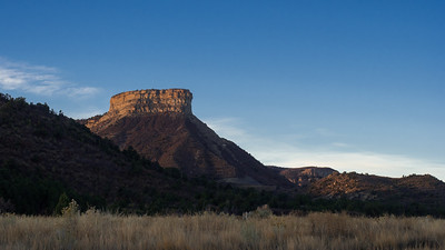 View of Point Lookout mesa at sunrise from the Mesa Verde visitor center.