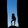 Silhouette of Lindsay between sandstone fins, Sand Dune Arch.