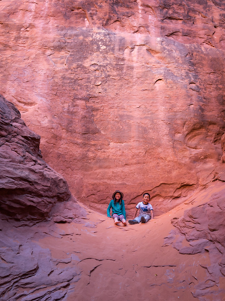 Lindsay and Nolan on little ledge behind Sand Dune Arch.