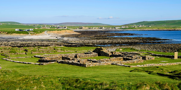"The Brough of Birsay is on a small island separated from the the Mainland by a natural tidal causeway.  Tourists need to wait for low tides to be able to visit.  (You can barely see the causway to the island and a tourist walking on it in this photo.)  There is evidence of Pictish inhabitants in the 7th and 8th centuries.  Why the Pictish people left is unknown, but by the 9th century the occupants of Birsay were Norse and it was the center up power in Orkney until the 12th century when Kirkwall rose in prominence.  In addition to the houses and church, we could see evidence of heating and drainage systems as well as possible remains of saunas.<br /> <br /> The church was built by by Earl Thorfinn in the mid-11th century after his return from the Crusades. (According to the Orkneyinga Saga, ""Earl Thorfinn made himself a great chief; he was the tallest and strongest of men, ugly, black-haired, sharp-featured, and big-nosed, and with somewhat scowling brows. He was a mighty man of strife, and greedy both of money and honour; he was lucky in battle, and skilful in war, and good in onslaught"")  The relics of St Magnus were initially kept in this church after his murder in 1116."