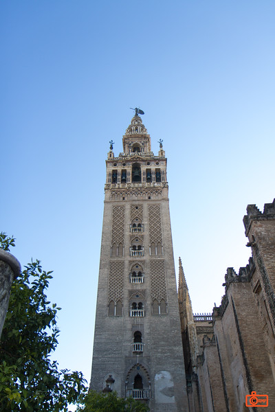 The Giralda is the bell tower of the Cathedral of Seville. Its height is 343 feet (105 m). It was originally part of a Moor mosque (1184) and converted to the bell tower after 1248.