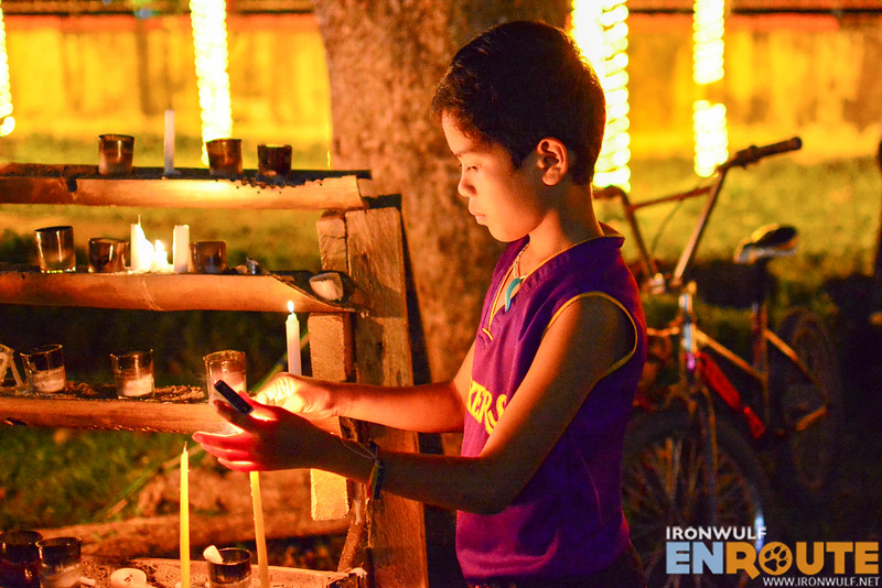 A boy lights a candle at Palo Cathedral