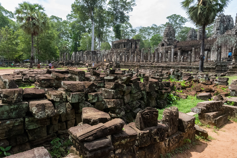 Field of loose blocks from Angkor Thom, 13th century Buddhist temple.