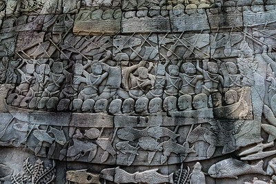 Extensive carvings of a historic battle between (Buddhist) Khmers and (Muslim) Chams. Angkor Thom, 13th century Buddhist temple.