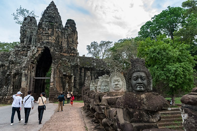 Restored heads along the causeway to Angkor Thom temple grounds.
