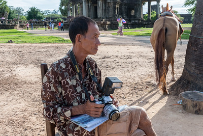 A photographer waits for customers; Angkor Wat, Cambodia