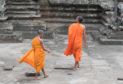 Two young monks visit Angkor Wat, Cambodia
