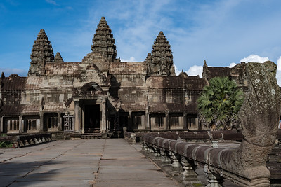 The west side of the central Angkor Wat walls, with five towers just visible behind; Cambodia
