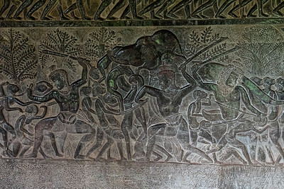 Bas relief carvings of a mythical battle among gods, Angkor Wat, Cambodia