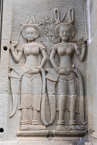 Two of the many-thousand Apsara dancers carved on the walls of Angkor Wat, Cambodia