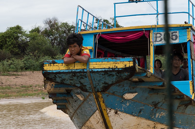 Another boy in the prow of a boat - On the way to Floating Village near Siem Reap, Cambodia.