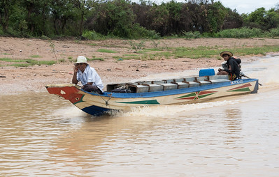 This gent maintains a cellphone while speeding from the Floating Village near Siem Reap, Cambodia.