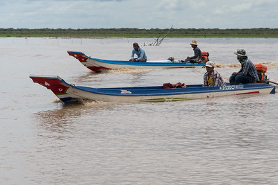 Two local boats seen near the Floating Village near Siem Reap, Cambodia.