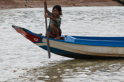 Girl in boat on the way to Floating Village near Siem Reap, Cambodia.