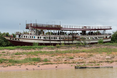 A large ship, waiting for rainy season to return - On the way to Floating Village near Siem Reap, Cambodia.