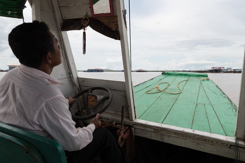 Our boatman navigates on the way back from Floating Village near Siem Reap, Cambodia.