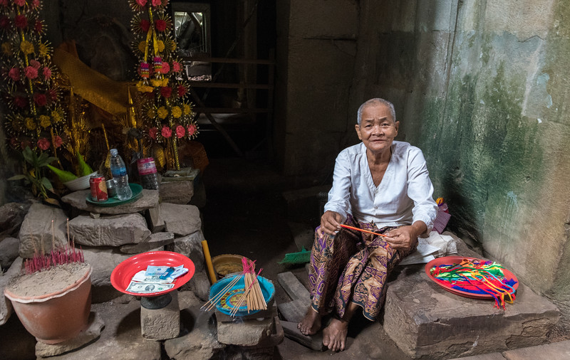 Selling incense and prayer bracelets at Ta Prohm - 11c Buddhist Angkor-area temple