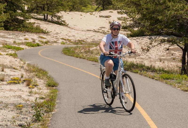 Pam riding along the Provice Lands bike path, Cape Cod.