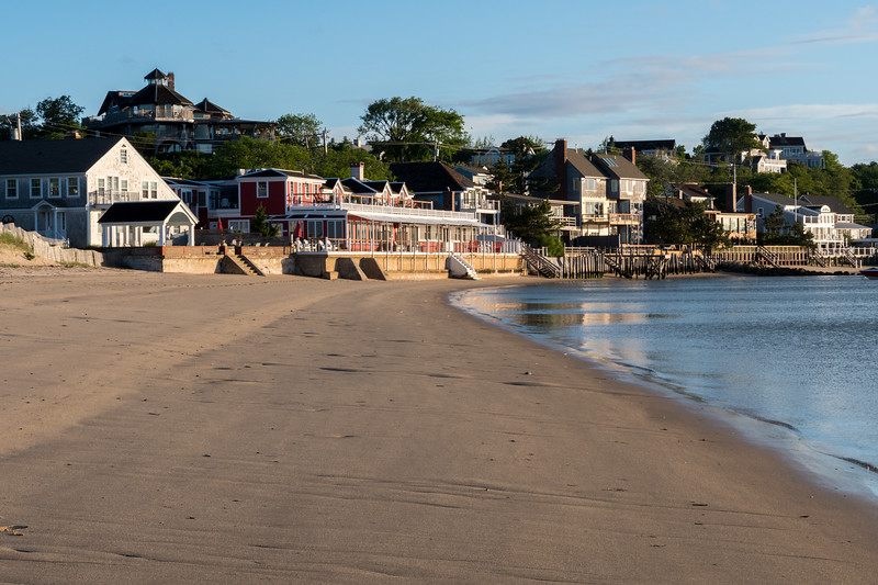 Sunrise on the beach, with Land's End Inn and Red Inn in view;  Provincetown Harbor, Cape Cod.