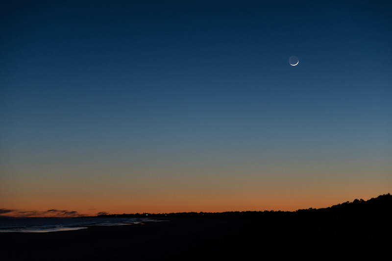 Crescent moon setting over Kiawah Island.
