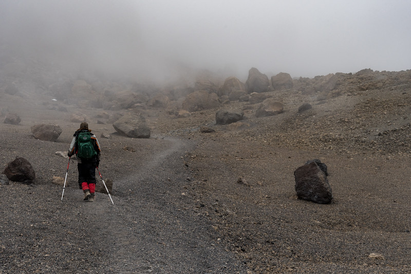 Ken crosses the crater in an eery mist.