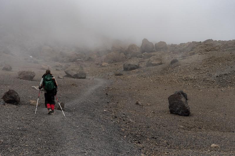 Ken crosses the crater in an eery mist.
